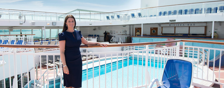 woman standing on a cruise ship
