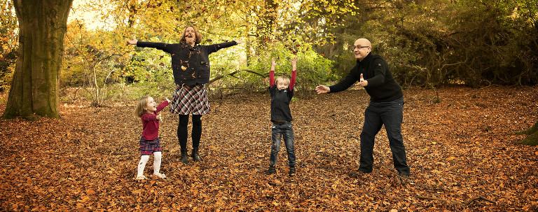 Family playing with leaves