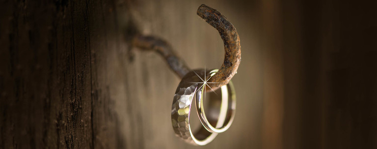 Wedding rings hanging on a hook